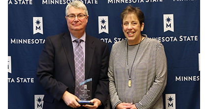 Don Lewis pictured with Laura King after Lewis accepted the Outstanding Services Award from Minnesota State at the 2018 CFO Annual Conference on Dec. 6, 2018