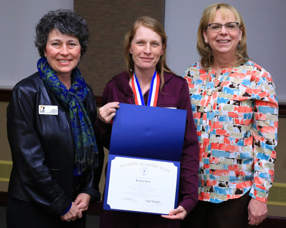Pictured from left to right is Elaina Bleifield (Vice President of Academic and Student Affairs), Kate Boyd (student accepting her certificate and medal) and Deborah Allen (Legal Administrative Assistant).