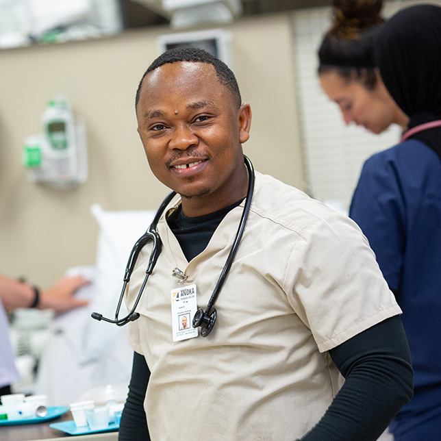 Male healthcare worker smiling.