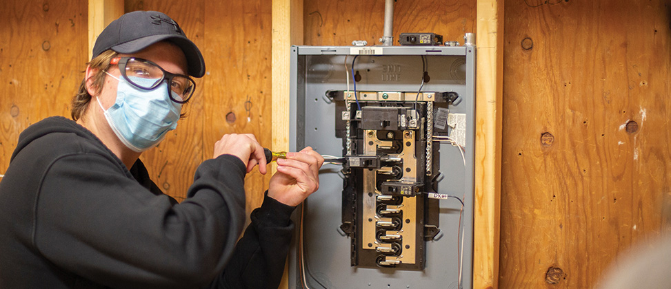 Construction student working on electrical panel